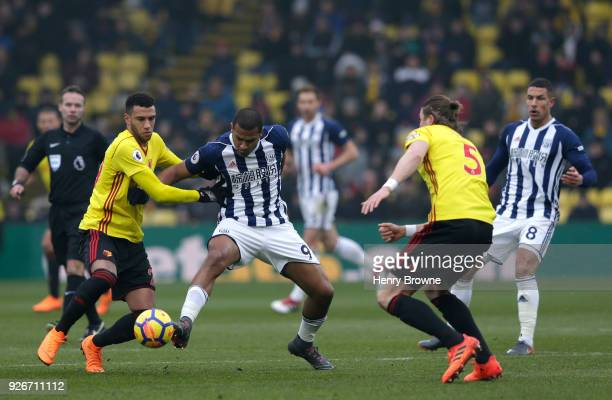 Jose Salomon Rondon of West Bromwich Albion is challenged by Etienne Capoue of Watford during the Premier League match between Watford and West...