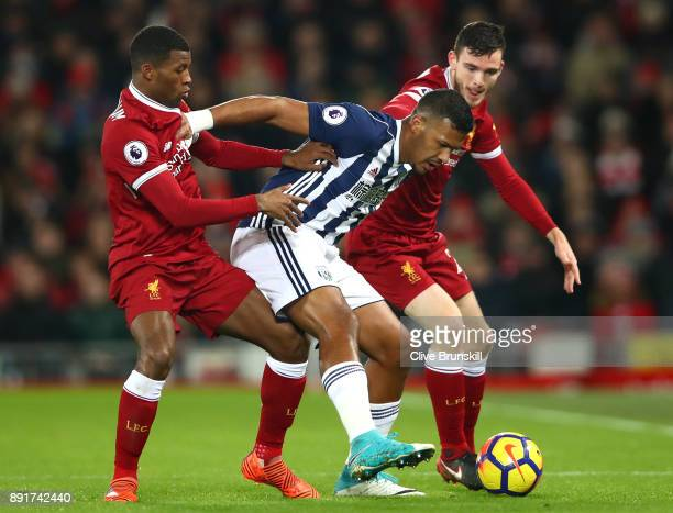 Jose Salomon Rondon of West Bromwich Albion is challenged by Georginio Wijnaldum of Liverpool and Andy Robertson of Liverpool during the Premier...