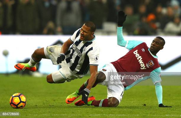 Jose Salomon Rondon of West Bromwich Albion is challenged by Pedro Obiang of West Ham United during the Premier League match between West Ham United...