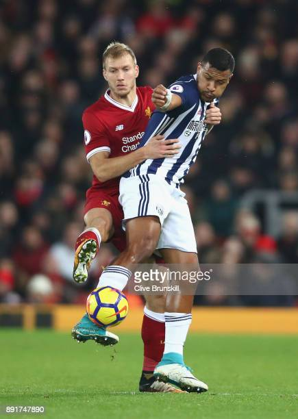 Jose Salomon Rondon of West Bromwich Albion is challenged by Ragnar Klavan of Liverpool during the Premier League match between Liverpool and West...