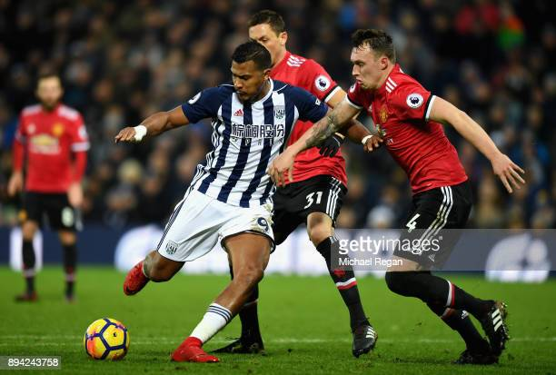 Jose Salomon Rondon of West Bromwich Albion is closed down by Phil Jones of Manchester United during the Premier League match between West Bromwich...