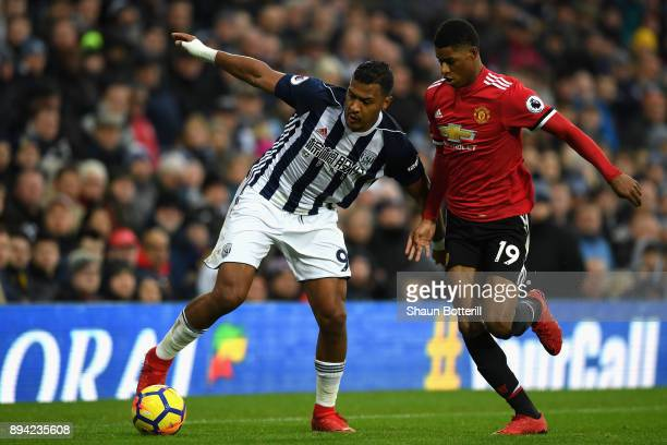 Jose Salomon Rondon of West Bromwich Albion runs with the ball under pressure from Marcus Rashford of Manchester United during the Premier League...