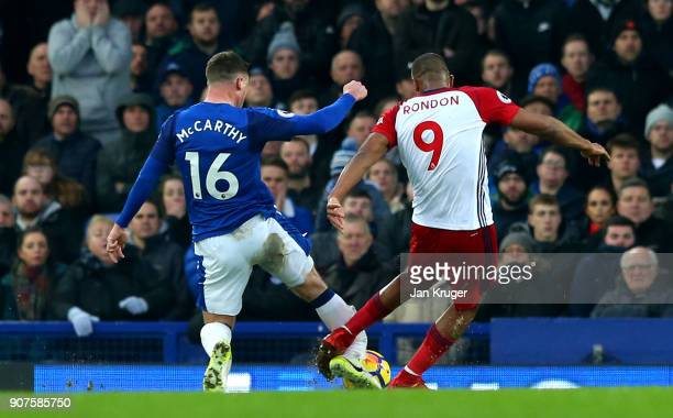 Jose Salomon Rondon of West Bromwich Albion tackles James McCarthy of Everton during the Premier League match between Everton and West Bromwich...