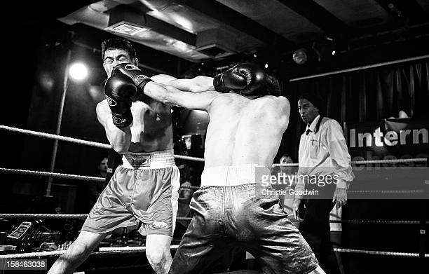Jose Sanchez and Ravil Galiakhmetov in the ring during the Chessboxing 2012 Season Finale at Scala on December 8 2012 in London England