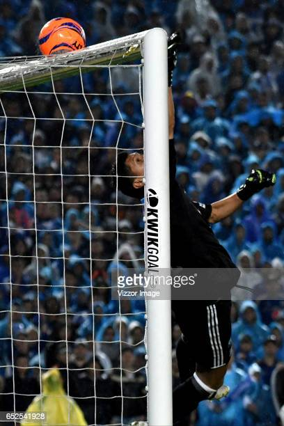 Jose Sanchez goalkeeper of Millonarios makes a save during a match between Millonarios and America de Cali as part of the round 9 of Liga Aguila I at...