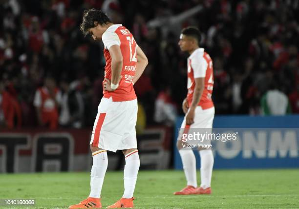 Wuilker Fariñez goalkeeper of Millonarios reacts after being injured by Damir Ceter of Santa Fe during a round of sixteen first leg match between...