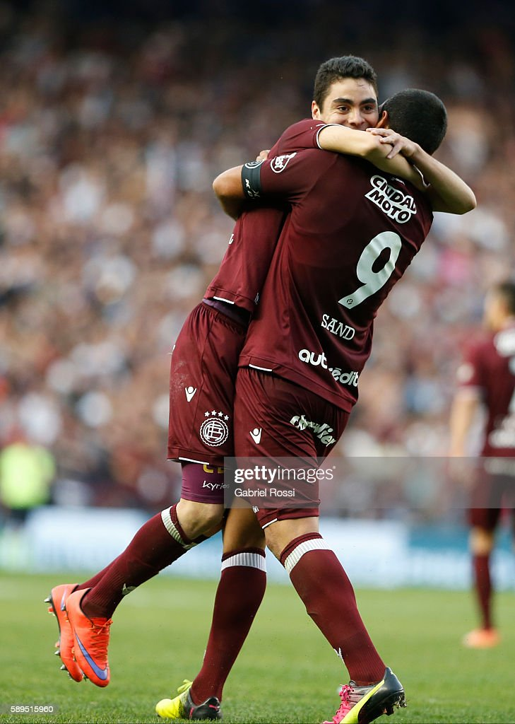 Jose Sand and Miguel Almir—on of Lanus celebrate their team's first goal scored by Brian Montenegro of Lanus (not in frame) during a match between Racing Club and Lanus as part of Copa del Bicentenario de la Independencia 2016 at Presidente Peron Stadium on August 14, 2016 in Avellaneda, Argentina.
