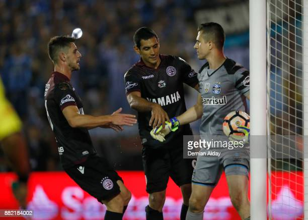 Jose Sand of Lanus asks Marcelo Grohe goalkeeper of Gremio for the ball after scoring a penalty kick during the second leg match between Lanus and...
