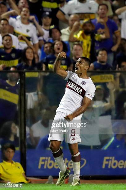 Jose Sand of Lanus celebrates his side's first goal with the teammate during a match between Boca Juniors and Lanus as part of Superliga 2018/19 at...