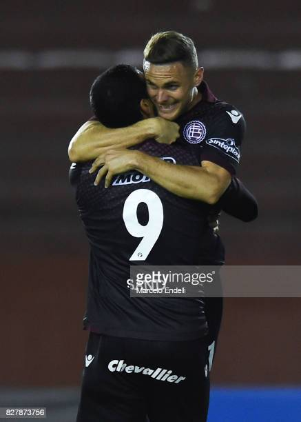 Jose Sand of Lanus celebrates with teammate Nicolas Pasquini of Lanus after scoring the opening goal during the second leg match between Lanus and...