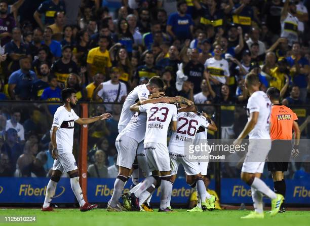 Jose Sand of Lanus celebrates with teammates after scoring the first goal of his team during a match between Boca Juniors and Lanus as part of...