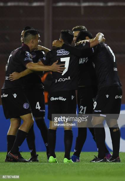 Jose Sand of Lanus celebrates with teammates after scoring the opening goal during the second leg match between Lanus and The Strongest as part of...