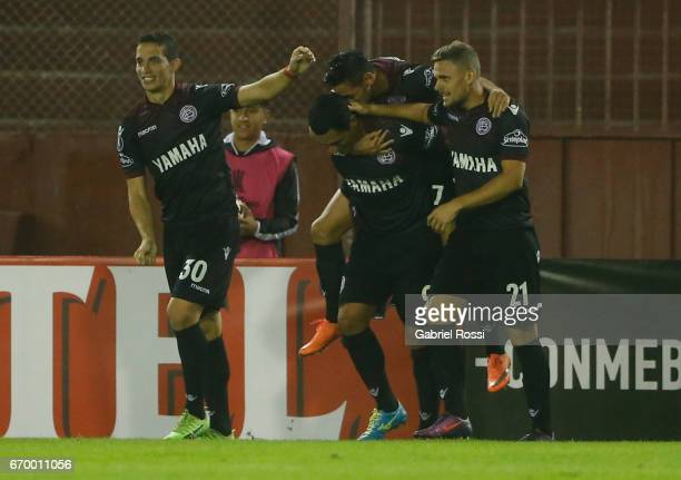 Jose Sand of Lanus celebrates with teammates Lautaro Acosta Ivan Marcone and Nicolas Pasquini after scoring the second goal of his team during a...