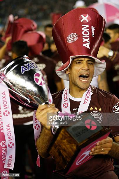Jose Sand of Lanus celebrates with the trophy after a final match between San Lorenzo and Lanus as part of Torneo Transicion 2016 at Monumental...