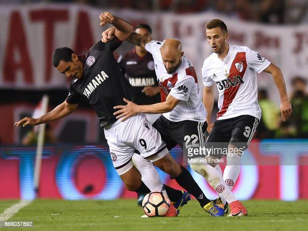 Jose Sand of Lanus fights for the ball with Javier Pinola of River Plate during a first leg match between River Plate and Lanus as part of semifinals...