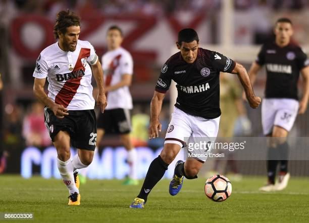 Jose Sand of Lanus fights for the ball with Leonardo Ponzio of River Plate during a first leg match between River Plate and Lanus as part of...