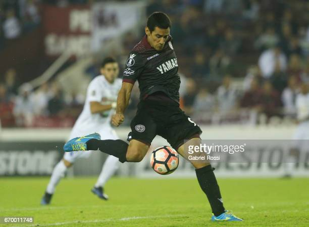 Jose Sand of Lanus kicks the ball to score the second goal of his team during a group stage match between Lanus and Zulia as part of Copa CONMEBOL...