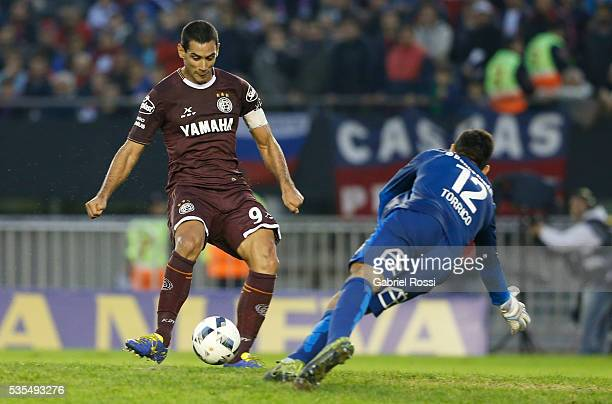 Jose Sand of Lanus shoots to score the third goal of his team during a final match between San Lorenzo and Lanus as part of Torneo Transicion 2016 at...