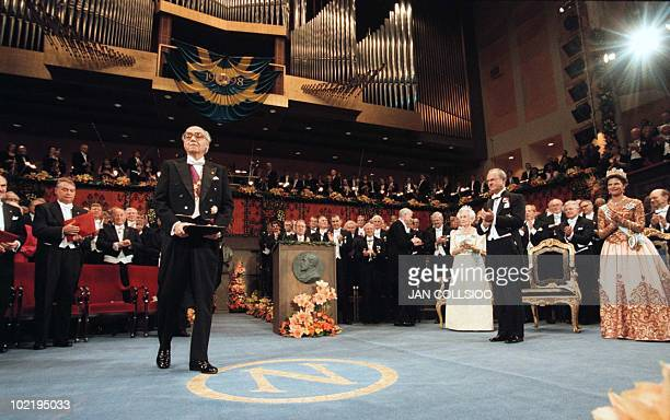 Jose Saramago bows after receiving the Nobel Prize for Literature from Swedish King Carl XVI Gustaf at the Concert Hall in Stockholm, Sweden,...