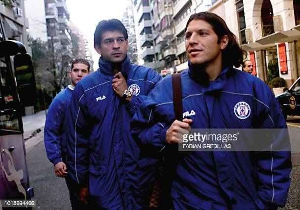 Jose Saturnino Cardozo and Pablo Manuel Galdames players of Mexico's Cruz Azul walk through Buenos Aires 26 June 2001 moments before getting in the...
