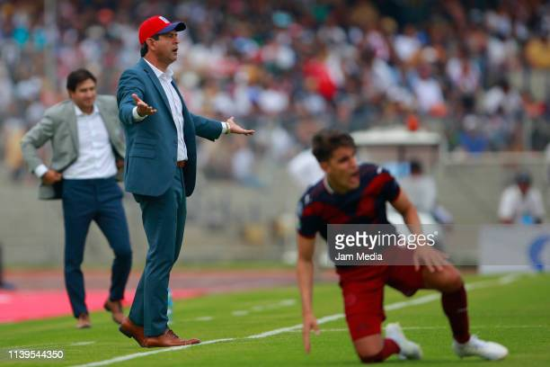 Jose Saturnino Cardozo coach of Chivas reacts during the 12th round match between Pumas UNAM and Chivas as part of the Torneo Clausura 2019 Liga MX...