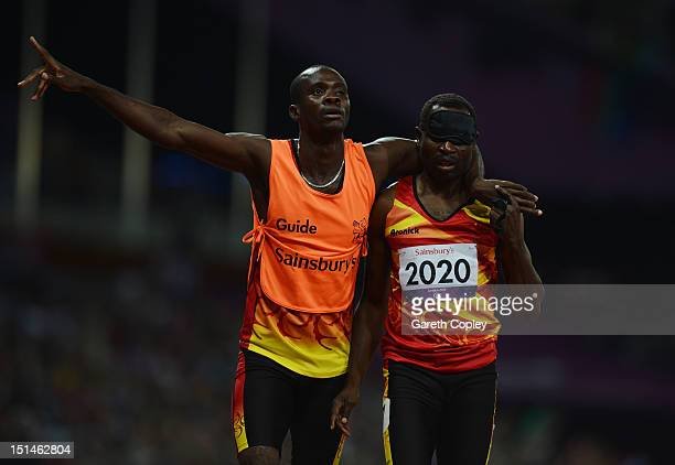 Jose Sayovo of Angola and guide Nicolau Palanca celebrate as they win gold in the Men's 400m T11 Final on day 9 of the London 2012 Paralympic Games...