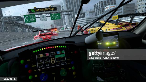 Jose Serrano of Spain battles with Takuma Miyazono of Japan during the Nations Cup race two of the FIA Gran Turismo World Tour 2020 Finals run at the...