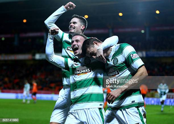 Jose Simunovic of Celtic is congratulated by team mates Leigh Griffiths and Mikael Lustig after scoring a goal in the first half during the Ladbrokes...