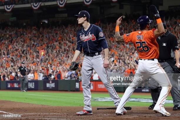 Jose Siri of the Houston Astros celebrates after scoring a run as Max Fried of the Atlanta Braves reacts during the second inning in Game Two of the...