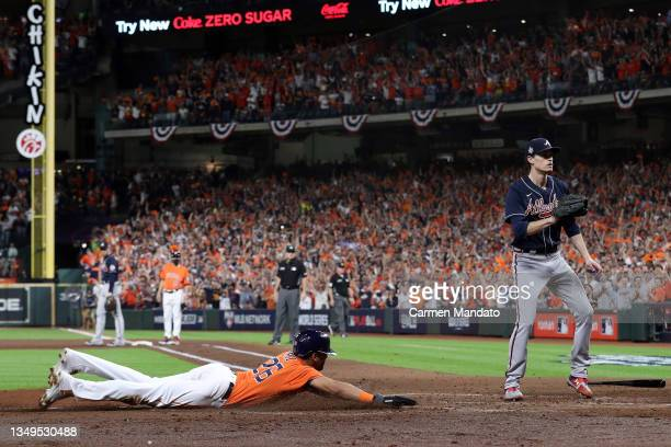 Jose Siri of the Houston Astros celebrates after scoring a run against the Atlanta Braves during the second inning in Game Two of the World Series at...