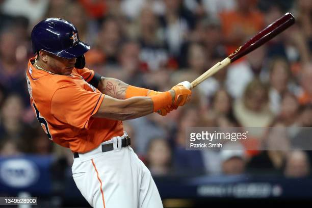 Jose Siri of the Houston Astros hits an RBI single against the Atlanta Braves during the second inning in Game Two of the World Series at Minute Maid...