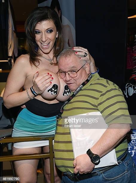 Jose Solis poses for a photo with adult film actress Sara Jay at the 2015 AVN Adult Entertainment Expo at The Joint inside the Hard Rock Hotel Casino...