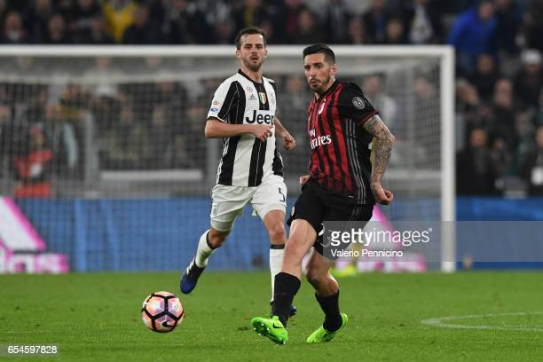 Jose Sosa of AC Milan in action against Miralem Pjanic of Juventus FC during the Serie A match between Juventus FC and AC Milan at Juventus Stadium...