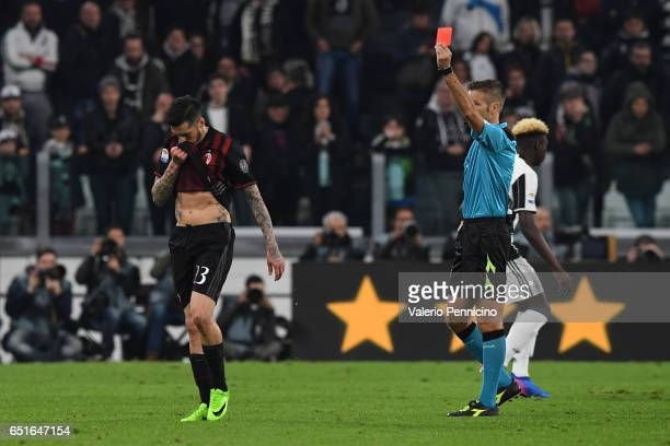 Jose Sosa of AC Milan receives red card from referee Davide Massa during the Serie A match between Juventus FC and AC Milan at Juventus Stadium on...