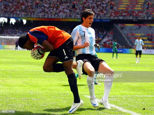 Jose Sosa of Argentina and Ambruse Vanzekin of Nigeria compete for the ball during the Men's Final between Nigeria and Argentina at the National...