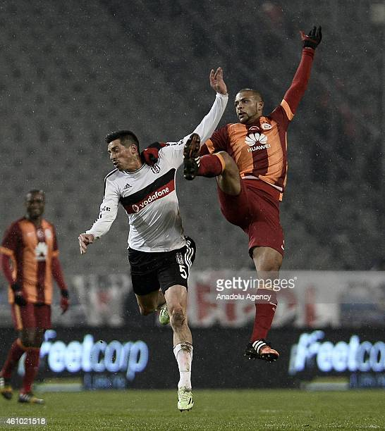 Jose Sosa of Besiktas vies for the ball with Felipe Melo of Galatasaray during the Turkish Spor Toto Super League soccer match between Besiktas and...