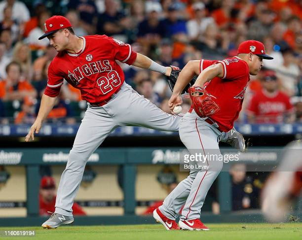Jose Suarez of the Los Angeles Angels of Anaheim attempts to make a play on a bunt by Jose Altuve of the Houston Astros in the first inning as Matt...
