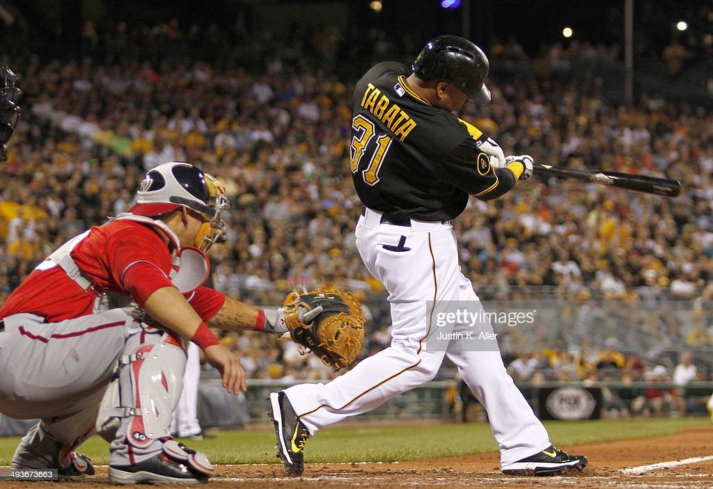 Jose Tabata #31 of the Pittsburgh Pirates hits a sacrifice fly in the seventh inning against the Washington Nationals during the game at PNC Park May 24, 2014 in Pittsburgh, Pennsylvania.