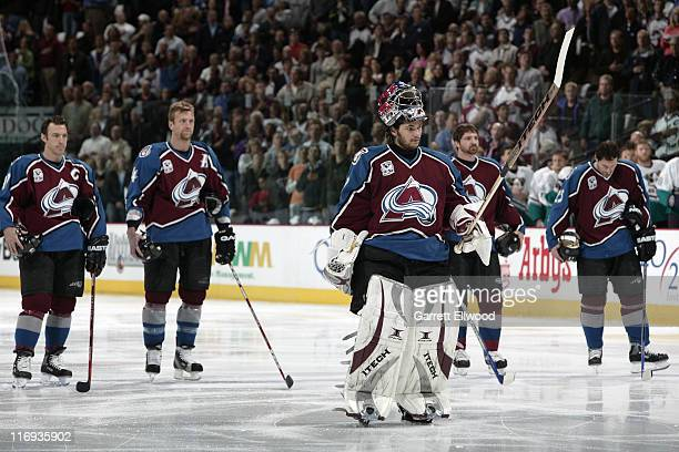 Jose Theodore and the Colorado Avalanche line up for the National Anthem prior to the against the Mighty Ducks of Anaheim during Game 3 of the...