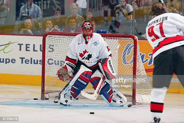 Jose Theodore of Team Canada stops pucks in warmups prior to their exhibition game against Team USA in the World Cup of Hockey on August 25 2004 at...