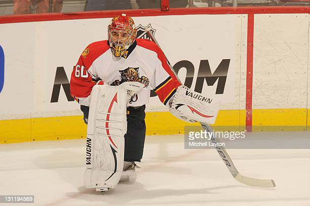 Jose Theodore of the Florida Panthers looks on during warmups of a NHL hockey game against the Washington Capitals on October 18 2011 at the Verizon...