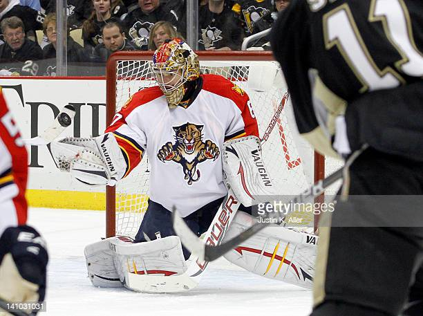 Jose Theodore of the Florida Panthers makes a glove save against the Pittsburgh Penguins during the game at Consol Energy Center on March 9 2012 in...