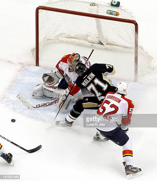 Jose Theodore of the Florida Panthers makes a save on Evgeni Malkin of the Pittsburgh Penguins during the game at Consol Energy Center on March 9...