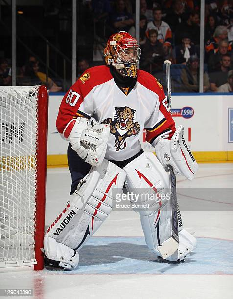 Jose Theodore of the Florida Panthers tends net against the New York Islanders at the Nassau Veterans Memorial Coliseum on October 8 2011 in...