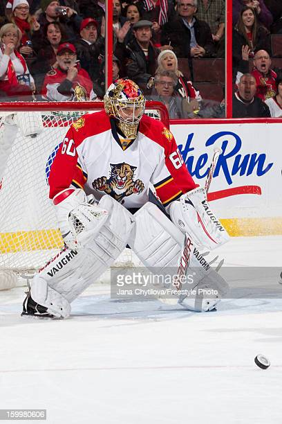 Jose Theodore of the Florida Panthers watches the loose puck during an NHL game against the Ottawa Senators at Scotiabank Place on January 21 2013 in...
