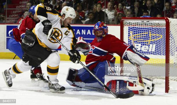 Jose Theodore of the Montreal Canadiens makes a pad save against Joe Thornton of the Boston Bruins during game six of the Eastern Conference...