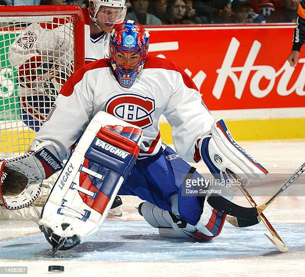 Jose Theodore of the Montreal Canadiens makes a save during a game against the Toronto Maple Leafs on October 3 2002 at the Bell Centre in Montreal...