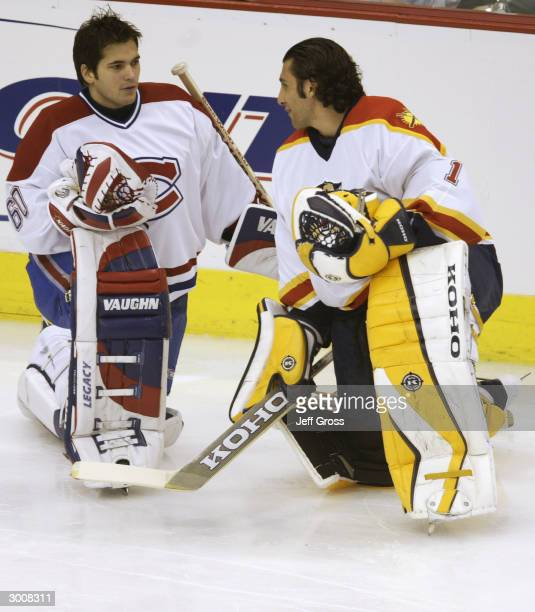 Jose Theodore of the Montreal Canadiens talks with Roberto Luongo of the Florida Panthers during the NHL AllStar Super Skills Competition on February...