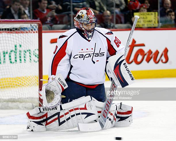 Jose Theodore of the Washington Capitals gets down to stop the puck during the warm up period prior to facing the Montreal Canadiens in the NHL game...