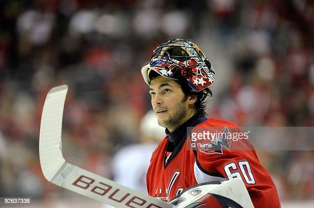 Jose Theodore of the Washington Capitals skates to the bench during a break in the game against the Columbus Blue Jackets at the Verizon Center on...